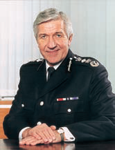 Sir Keith Povey, QPM, LLD (Hon), BA (Law), CCMI