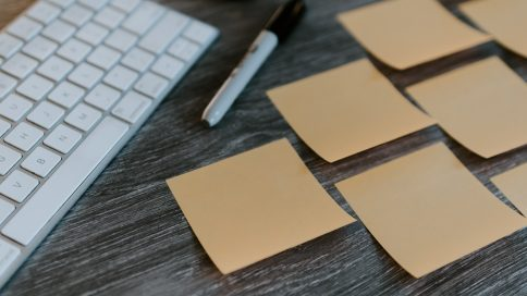 Sticky notes in front of a computer keyboard